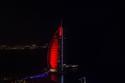 معالم إماراتية وعربية تزينت باللون الأحمر