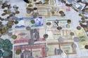 صور: أشكال العملات العربية وتطورها عبر التاريخ