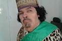 الفنان علاء مرسي وهو يقلد الرئيس الليبي السابق معمر القذافي