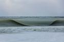 صور تجمد أمواج البحر في أمريكا لشدة البرودة