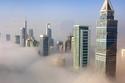 شاهد أبراج دبي وسط الضباب في مشاهد تخطف الأنفاس