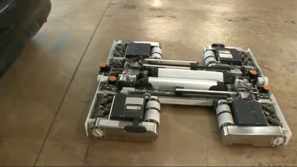 فيديو: روبوتات صغيرة قادرة على رفع السيارات ونقلها من مكانها
